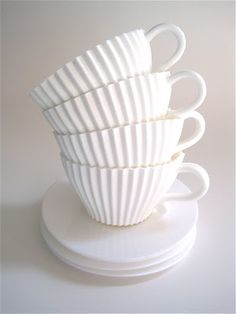 These are silicone teacups... you pour cake batter in them, and bake them. You then have a cupcake in your teacup to frost and display on the saucers.