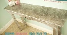 tin foil table mimics mirrored table look.  Get out the Modge Podge and add a light metallic glaze