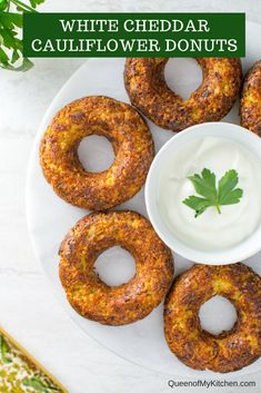 White Cheddar Cauliflower Donuts - A savory gluten-free donut made from cauliflower that'll turn vegetable haters into veggies lovers! Each donut contains the equivalent of one serving of cauliflower. | QueenofMyKitchen.com | #donut #donuts #doughnut #doughnuts #cauliflower #veggies #veggielove #glutenfree