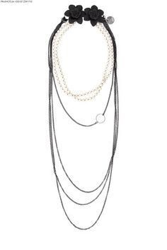 This beautifully versatile neck piece can reinvent itself every time you wear it. The double linked matted chain falls in four layers and hosts a sterling silver hoop mid way. Two beautiful strings of 8mm water pearls run approximately 20inches in parallel lengths and attach Coco flowers and a slinky matt chain.  €445 #Pearls #flapper