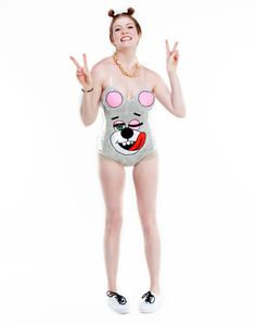 Twerkin Teddy Adult Women's Costume exclusively at Spirit Halloween -  Twerk it out the best you can on Halloween when you decide to shock everyone with this Twerkin Teddy Adult Women's Costume. This one-piece bear leotard features an embroidered teddy with its tongue hanging out! You'll surely be remembered! Make this Teddy yours for $39.99.
