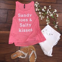 Sandy Toes & Salty Kisses Tank Sandy Toes & Salty Kisses Coral Pink Tank! Loose Comfortable Fit! Super Cute for Summertime and Beach Days! 95% Rayon 5% Spandex. Made in USA!  Sizes Available: S,M,L  *Please allow me to make a new listing for you with your size* Thank You! Xo Tops Tank Tops