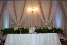 Blush pink and white for this Harvest themed wedding reception.  Fresh greenery mixed w faux blush florals.  Decor done by FCCDECOR- affordable event decor.