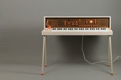 DIY Modular Synthesizer Encased in a Beautiful 1970s Era Keyboard Stand With a Fold-Over Top