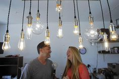 All's Fair In Love At Art-A-Faire #industriallighting #edisonbulbcandeliers
