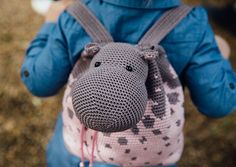 """Pattern in """"Crochet Kids' Bags"""" book by Chabepatterns // A cute dino backpack to guard your lunch, soft pajama keepers to stash your PJ's away for the night, a two-sided pencil case to store your multi-colored pens, a soft bag to put your favorite toys away for the next day ... A child's life is filled to the brim with different activities and outings, and what better way to keep it all organized than with cute and soft amigurumi bags?"""