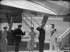 Queen Elizabeth II, followed by the Duke of Edinburgh Prince Philip, steps from her plane at Eagle Farm airport onto Queensland soil on March 9, 1954.