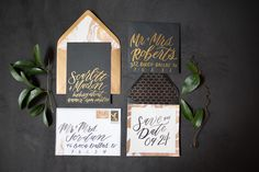 Custom Wedding Invitation Design featuring gold metallic brush script on black paper for a glamorous look perfectly tailored to the modern bride. Sarah Ann Design: www.sarahanndesign.co