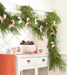 Reindeer Games Garland: recycle old Christmas cards to dress up a handsome evergreen garland. Trace the Christmas shape onto old cards and cut them out. Thread red string through holes punched in the tops to hang from the swag. Old Christmas, Very Merry Christmas, Christmas Bells, All Things Christmas, Christmas Holidays, Christmas Wreaths, Christmas Crafts, Christmas Decorations, Christmas Ideas