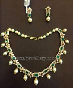 22 carat gold nice flower clasps and square shaped emeralds combination simple yet elegant choker with south sea pearls and emerald beads...