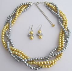 Check out this item in my Etsy shop https://www.etsy.com/listing/189941864/golden-yellow-gray-pearls-twisted
