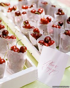 Seasonal fruits make wonderful (and delicious) favors -- these sacks of fresh cherries are perfect for summer