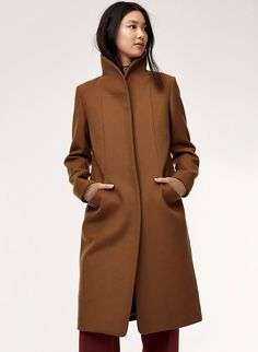 The longer version of Wilfred's streamlined, beautifully structured Cocoon coat has a cozy collar that can be worn up or down. It's made with an exceptionally warm wool-cashmere fabric from a premier Italian mill. Brown Wool Coat, Camel Coat, Cashmere Fabric, Winter Coat, Autumn Winter Fashion, Winter Outfits, How To Wear, Long Coats, Flannel