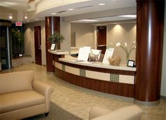 recpetion office with curve walls - Google Search Optometry Office, Heart Care, Curved Walls, Clinic Design, Lobby Design, Waiting Area, Wood Stone, Reception Areas, Office Designs