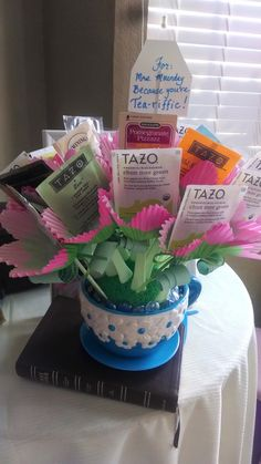 """Teacher Appreciation Week: Tea Bouquet. I used spoons and cupcake wrappers with the tea bags to make them look like flowers.  For the leaves, I tied green ribbon around the spoons. Attached to the ribbons are inspirational Bible verses printed on green paper, and rolled up. These add to the leaf effect and make it like """"fortune"""" tea bags (instead of fortune cookies). One verse per bag, so you never know what the verse will be until you untie your tea."""