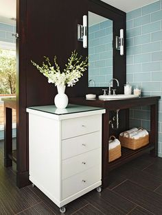 Rolling vanity carts to hide clutter? Think I would rather have a kneespace here, but the rolling cart could be useful elsewhere in the bath.