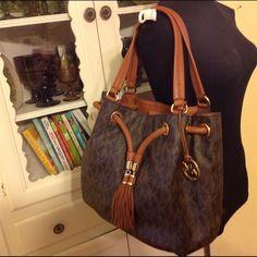 MK Drawstring Monogram Handbag In good pre-owned condition. Michael Kors Bags Hobos