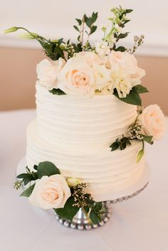 Sweet two tiered wedding cake with flowers