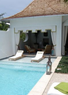 garage style pool house. love the long pool steps perfect for loungers.