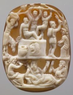 Cameo: Harvest and grapes  Roman, Imperial period  2 - 3 Century AD  Onyx, white on light brown. A modern mounting: silver, gold plated. http://bilddatenbank.khm.at/viewArtefact?id=59186