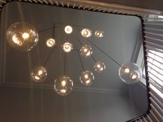 Hand blown glass large Pick-n-Mix ball pendant lights on a multiple plate/stairwell, by Rothschild & Bickers