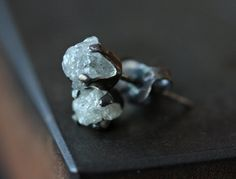organic, edgy and refined.  These are meant for the not so typical diamond stud gal...a modern, updated version. To me, theyre kind of humorous and