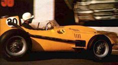Olivier Gendebien's yellow Ferrari 246 Dino at the 1958 Belgian GP ~ in these early GP days there was no advertising on the cars. Instead of using a sponsor as their identity, race team painted there cars according to the nationality of the team. Italy - red, England - green, Germany - white then silver, U.S. - white with two blue stripes, Scottish - dark blue and Belgium - yellow.