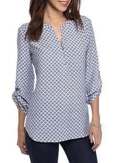 42823160e78 Add some pretty print to your closet with this split neck printed top by  Kim Rogers®. This beauty can be worn to work or during your off-duty  activities for ...