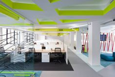 Co-Work Angel by PENSON. Tags: workplace, office, interior design, bright bold colours, ceiling, highlighter yellow, workstations, desk, office chair, open space, meeting room, glazing