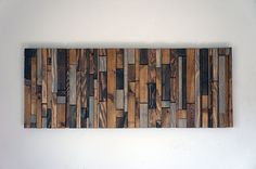 This piece is made to order. Lead time for shipping is 4 to 6 weeks.  The photo shown is a previously sold beautiful modern art piece made with reclaimed wood. We have finished each piece of wood by hand then used 5 different shades of stain. These natural colors keep the rustic look of the wood by bringing out the grain while also giving it a modern touch by the way the pieces are placed together. This would look great hanging horizontally above a headboard in a bedroom, above a couch in a…