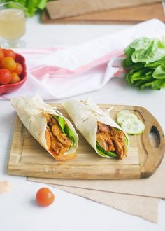 Easy wraps made with incredible homemade peri peri chicken thighs, avocado, tomato, lettuce, and peri peri sauce. Fantastic lunch or dinner idea for any night of the week! These Peri Peri Chicken Wraps are packed with flavor! Easy, homemade peri peri marinade will blow your socks off! #chickenrecipes #wrapsrecipes #periperi