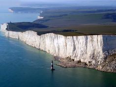 Beachy Head is a chalk headland in Southern England, close to the town of Eastbourne in the county of East Sussex, immediately east of the Seven Sisters. The cliff is the highest chalk sea-cliff in Britain, rising to 162 metres ft) above sea level. East Sussex, White Cliffs Of Dover, Visit Uk, Costa, Lake District, Places To See, Travel Inspiration, Food Inspiration, The Good Place