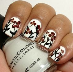 Rin's Nail Files: Sinful Snow me White with free handed flowers....