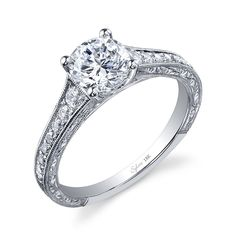 Style# SY886 Classic Round Brilliant Tapered Diamond Engagement Ring - This vintage inspired, white gold engagement ring features a 1.25 carat round sparkling diamond solitaire placed on a tapered shank accented with graduated diamonds nestled in channel framed in milgrain beading. https://www.sylviecollection.com/classic-round-brilliant-tapered-diamond-engagement-ring-sy886