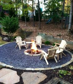 Gravel Patio with Firepit. This is a great idea for around my fire pit I think! :)