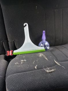 Banish animal hair from your upholstery with a spray bottle of water and a squeegee. | 23 Ways To Make Your Car Cleaner Than It's Ever Been