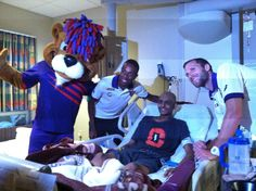 Orlando City Player's Dennis Chin and Rob Valentino along with mascot Kingston visit the children of Orlando Health- Arnold Palmer.