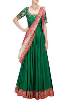 a green flared kalidaar anarkali in silk base with gold floral pattern zardozi and zari embroidery on the front and sleeves. It has intricate embroidered border on red base at the edges. It comes along with gold khada dupatta with red and gold zari embroidered border.