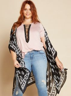 """<div>The beautiful white border print on this kimono is like a work of art that we want hanging in our house. Except then we wouldn't be able to wear it all the time! The whisper light black linen material has a sweeping effect with slightly draped armholes.</div><div><br></div><div><b>Model is 5'9"""", size 1</b></div><div><ul><li style=""""list-style-position: insid..."""