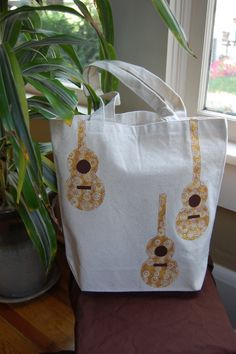 13 X 13 Three Acoustic Guitars Neutral Canvas Tote by ShopMelissa, $18.00