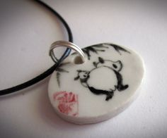 Pandpainted high-fire Porcelain pendant with sterling silver hardware by Tracie Griffith Tso of Reston, Va. Available at the Torpedo Factory Art Center, Studio 19 Panda# jewelry#
