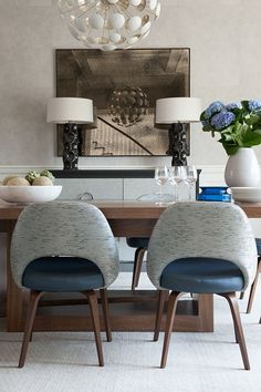 Classic modern dining room with blue and taupe colour scheme | Walnut dining table and iconic mid-century modern chairs | Weitzman Halpern Design