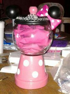 Mickey Mouse Party ~ Decoration ~ Candy bar container idea  |  NEED: Terra Cotta Plant (with saucer base), Medium Wooden Balls and small wooden balls (found at craft store), Hot glue gun, Round Bubble Bowl (found at WalMart), Spay Paint (Black and Red), White paint (trouser buttons)