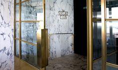 The Sugar Club - Metalier Coatings - liquid metal - door design - brass doors - metal veneer