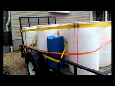 Free Rain Barrels from Pepsi bottling in some areas.  Call your local soda bottling company and ask if they will give you these for FREE.  Some will.