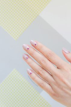 Pair your nude nails with geometric jewel tones to give your summer manicure an elevated look.
