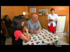 """Andrew Zimmern travels to Mongolia's busiest markets to try out their foods. First he heads to a restaurant to eat a sheep head which is considered a delicacy just like turkey on thanksgiving. He heads to the market and eats Mongolia's version of liverwurst and boiled animal head-> """"meat jello"""", """"cookie dough in rotten milk"""", """"Butter aged in cow stomach"""", etc."""