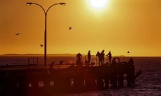 WAN-0000716 © WestPix PICTURE BY NIC ELLIS  17 SEPTEMBER 2014  THE WEST AUSTRALIAN  Fishers on the jetty at Coogee Beach at sunset.
