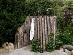 Although I doubt I ever do this, I absolutely love this outdoor shower. for our someday lake house.