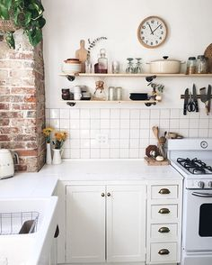 Exposed brick and white rustic kitchen